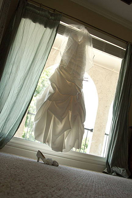 Brides dress hanging in bridal room at the Tennessee River Place