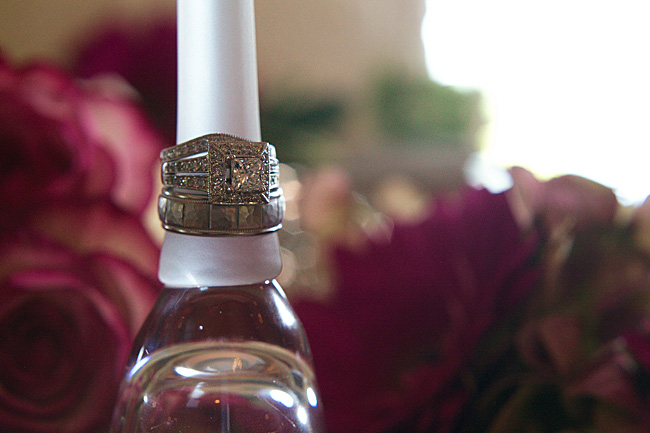 Bride and groom rings on flute glass