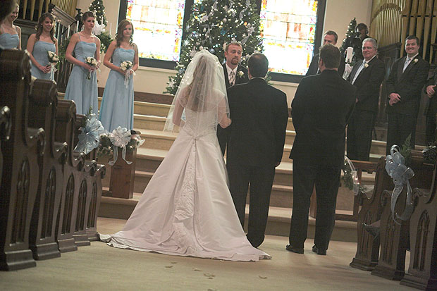 Father giving the bride away during wedding Ceremony at Asbury Chapel Highland Park Baptist Church.