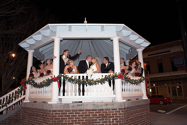 Bride and groom with wedding party at gazebo downtown Cleveland Tennessee.